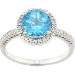 Prsten z bílého zlata s modrým topazem a diamanty