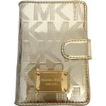 Zlatá peněženka / pouzdro na doklady Michael Kors pale gold metallic