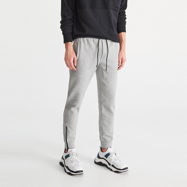 c033a05d4871 ... Teplákové kalhoty slim fit - Světle šed. -44%. Reserved ...