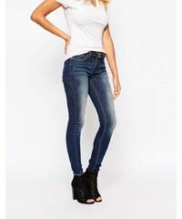 Grain Denim Grain - Schmale Denim-Jeans in Dirt-Waschung mit mittelhohem Bund - Blau