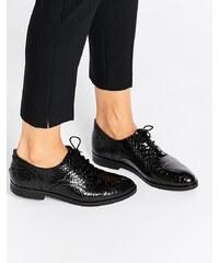 Bronx - Chaussures à enfiler en cuir verni effet serpent - Noir