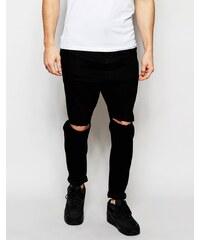ASOS - Schwarze Jeans mit tiefem Schritt und Zierrissen an den Knien - Schwarz