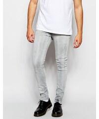 ASOS - Sehr enge Skinny-Jeans mit hellgrauer Beschichtung - Grau