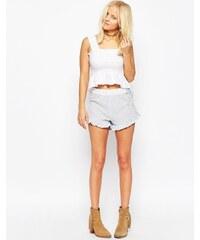 ASOS - Seitlich geschnürte Web-Shorts mit Rüschenrand - Mehrfarbig
