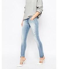Cheap Monday - Jean slim taille basse effet usé - Bleu