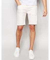 ASOS - Short en jean stretch coupe slim effet déchiré et rapiécé - Crème