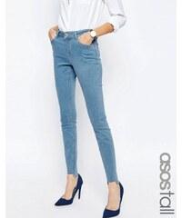 ASOS TALL - Lisbon - Jean skinny taille mi-haute avec ourlet brut asymétrique et délavage clair Honey - Bleu