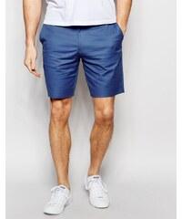 ASOS - Eng geschnittene Shorts aus Baumwolle in blauer Denimwaschung - Marineblau
