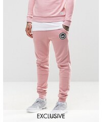 Hype - Pantalon de survêtement skinny avec logo armoiries - Rose