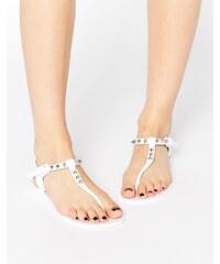 Religion - Solitary - Sandales plates en plastique souple avec entredoigt clouté - Blanc