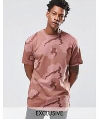 Reclaimed Vintage - T-shirt oversize surteint à motif camouflage - Rose