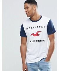 Hollister - Schmales Muskel-T-Shirt mit Retro-Logo & Ringerrücken in Weiß - Weiß