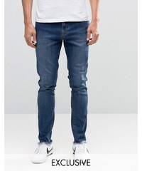 Brooklyn Supply Co - Enge Dumbo-Jeans in Vintage-Waschung mit unbearbeitetem Saum - Blau