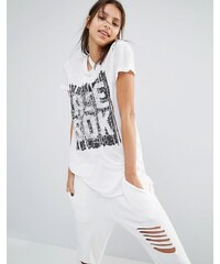 Reebok - T-shirt avec logo sur le devant et ourlet asymétrique - Blanc