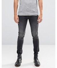 ASOS - Sehr enge Jeans in verwaschenem Schwarz mit Satin und Streifen an der Seite - Schwarz