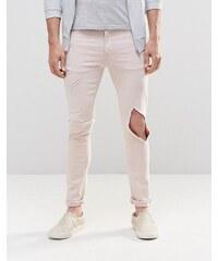 ASOS - Jean super skinny avec larges déchirures - Rose clair - Rose