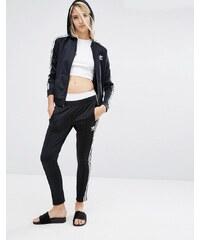 adidas Originals - Pantalon de survêtement resserré aux chevilles à trois rayures - Noir