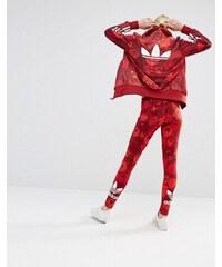 adidas Originals - Leggings à fleurs avec logo trèfle - Rouge