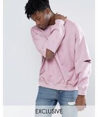 Reclaimed Vintage - Überfärbtes Oversize-Sweatshirt mit aufgeschlitzten Ellbogen - Rosa