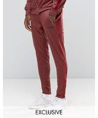 Puma - Pantalon de survêtement fuselé bordé de velours - Exclusivité ASOS - Rouge