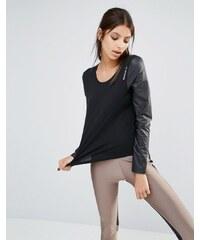 Reebok - T-shirt ample avec manches en similicuir - Noir