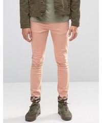 ASOS - Jean super skinny avec revers motif camouflage - Rose - Rose