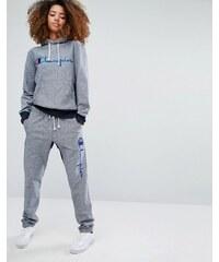 Champion - Pantalon de jogging décontracté avec logo texte - Bleu marine