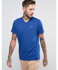 Hollister - Must Have - Schmales T-Shirt mit V-Ausschnitt in Blau mit meliertem Seagull-Logo - Blau
