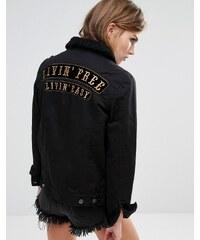 Lira - Oversize-Boyfriend-Jeansjacke mit Slogan auf dem Rücken - Schwarz