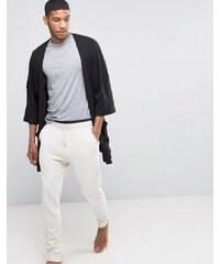 ASOS Loungewear - Pantalon de survêtement avec double taille - Beige
