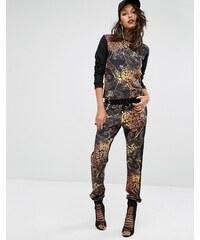 Versace - Jeans mit Animal-Print im Jogginghosen-Stil mit Waffelstruktur-Einsatz - Schwarz