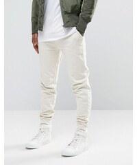 ASOS - Pantalon de survêtement skinny - Blanc cassé - Beige