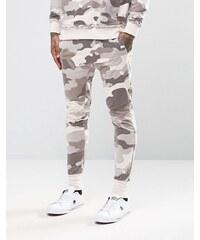 Other UK - Pantalon de jogging skinny à entrejambe bas motif camouflage - Rose