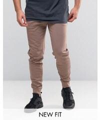 ASOS - Pantalon de survêtement skinny oversize - Beige - Rose