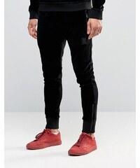 Religion - Pantalon de jogging slim en jersey avec écusson en métal et cheville zippée - Noir