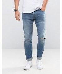 Hollister - Skinny-Jeans mit Stretch und Flicken, mittelblaue Waschung - Blau