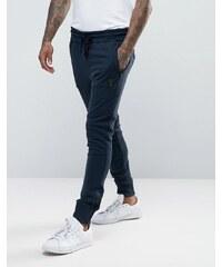 Religion - Pantalon de jogging slim en jersey avec écusson en métal et cheville zippée - Bleu marine