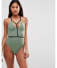ASOS - Maillot de bain contrasté style harnais élastiqué avec décolleté plongeant - Vert