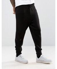 ASOS - Pantalon de jogging en maille à entrejambe bas et effet filé - Noir