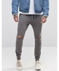 ASOS - Pantalon de jogging super skinny avec déchirures aux genoux - Anthracite - Gris