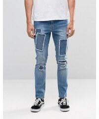 Brooklyn Supply Co - Dumbo - Jeans in mittlerer Waschung mit Flicken und Rissen am Knie - Blau