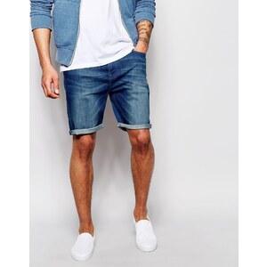 ASOS - Schmale, elastische Jeansshorts mit Waschung - Mittelblau
