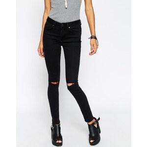 ASOS - Lisbon - Enge Jeans mit mittelhohem Bund und zwei versetzten Knierissen in verwaschenem Schwarz - Verwaschenes Schwarz
