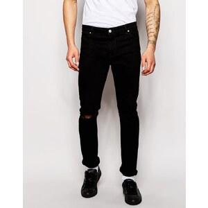 ASOS - Skinny-Jeans mit Abnutzungen am Knie - Schwarz