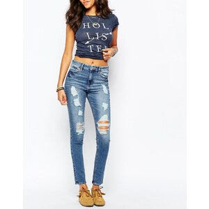 Hollister - Superskinny Jeans mit hoher Taille in starker Used-Optik - Mittelblau