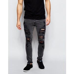 ASOS - Super Skinny Jeans mit starken Rissen in verwaschenem Schwarz - Schwarz