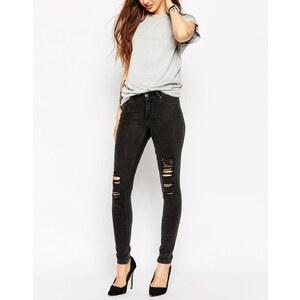 ASOS - Lisbon - Skinny-Jeans in verwaschenem Schwarz mit mittelhohem Bund und Zierrissen - Grau