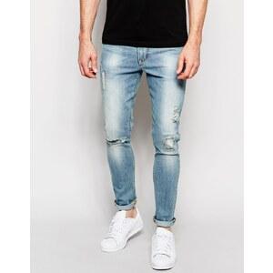 ASOS - Superenge Jeans mit zerschlissenen Aufnähern in ausgeblichenem Blau - Ausgeblichenes Blau