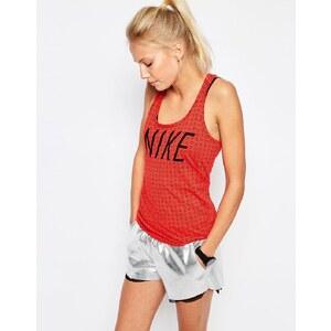 Nike - Débardeur à dos nageur et inscription du logo - Rouge