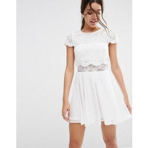 ASOS - Mini robe en dentelle avec top court - Blanc